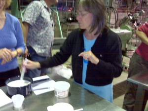 Board Secretary Marilyn Henderson learning to make queso fresco