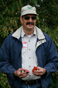 Jim Myers, of Oregon State University's horticulture eepartment, shows off the rare black tomatoes he's breeding.