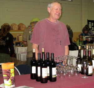 One of over 30 vendors at the 2012 Terra Madre Day event, Charlie Gilson of Pheasant Court Winery (Philomath, Oregon) offers tastings of two of the more unusual Willamette Valley wines, Roussane and Marechal Foch.