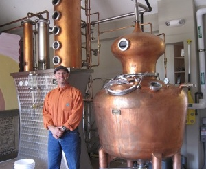 Chris Neumann proudly stands by the Vivacity copper still, a work of art with a story for any interested taster of Vivacity spirits!